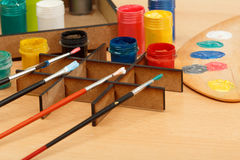 Motley paints and brushes ready for painting Royalty Free Stock Photography