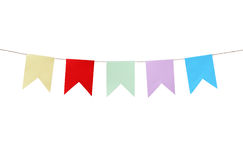 Motley Paper Flags. Few motley paper flags hanging with rope on white background. Clipping path is included Royalty Free Stock Image