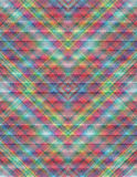 Motley pattern collected from the intersecting colored rhombuses Stock Images