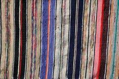 Motley rug textile fabrics texture Stock Image
