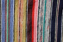 Motley rug textile fabrics texture. Close up of beautiful colorful hand made motley rug or carpet Stock Image