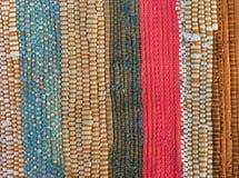 Motley rug textile fabrics texture closeup Stock Images
