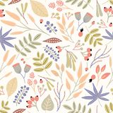 Motley seamless pattern with berries, leaves and inflorescences on white background. Decorative botanical backdrop. Beautiful vector illustration for textile Royalty Free Stock Images