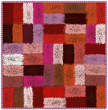 Motley tapestry with grunge woven rectangular colorful elements and wavy fringe Stock Photo