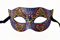 Motley Venetian Carnival half mask with ribbon isolated on white background royalty free stock photography