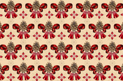 Motley yellow background with bells, pine cones and red bows Stock Images