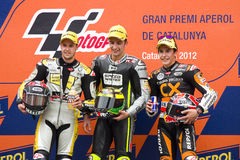 Moto 2 Podium. BARCELONA - JUNE 3: Thomas Luthi (2nd), Andrea Iannone (1st) and Marc Marquez (3rd) (L-R) in the podium after the race of Moto 2 Grand Prix of Royalty Free Stock Photo
