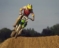 Moto 4. Motorcycle racer jumping bike in air royalty free stock photography