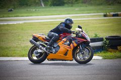 Moto-athlete begins to race on the racetrack royalty free stock photo