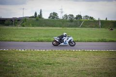 Moto-athlete on the racetrack stock photography