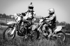 Moto biker driving enduro bike. Moto bikers driving enduro bike Royalty Free Stock Image
