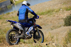 Moto biker driving enduro bike. Moto cross Royalty Free Stock Photography