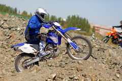 Moto biker driving enduro bike Stock Photo