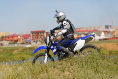 Moto biker driving enduro bike Royalty Free Stock Image