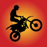 Moto-Cross-Driver. The Silhouette of a Moto-Cross-Driver in front of a red-yellow Background. This file is also available as Illustrator-file Royalty Free Stock Image