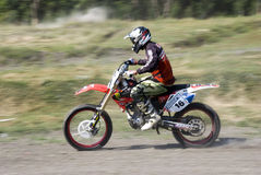 Moto-crossmitfahrer Stockfotografie