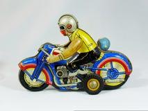 Moto de jouet de bidon photographie stock
