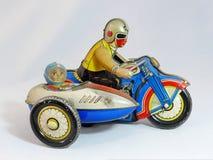 Moto de jouet de bidon Photographie stock libre de droits