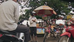 Moto driver , market, cambodia, southeast asia stock video footage