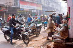Moto drivers on the street with crazy traffic of people Stock Images