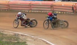 Moto duo enters a dangerous turn. Vladivostok, Primorsky Region, Russia - October 10th, 2015: Vladivostok, Avangard stadium, speedway races Big Vladivostok, on a Stock Photography