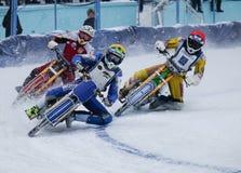 Moto emballant sur la glace Image libre de droits