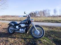 Moto en un paisaje Fotos de archivo