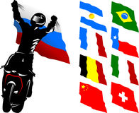 Moto flag. A silhouette of a motorcycle racer commits high jump Stock Photo