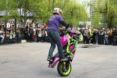 Moto free style pilot stunting on the square Stock Photos
