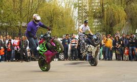 Moto free style pilot stunting on the square Royalty Free Stock Images