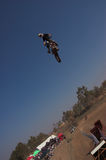 Moto X Freestyle 15. Moto X Freestyle rider high in sky with crowd in background Royalty Free Stock Image