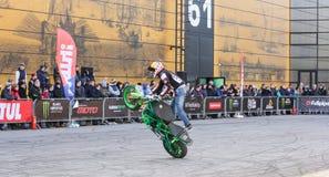 Moto freestyle on a green bike. Royalty Free Stock Photo
