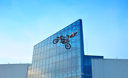 Moto freestyle show on area. KRASNOYARSK - MAY 22: Moto freestyle show on area in front of the shopping center Lights with view on blue building on May 22, 2011 Stock Photos