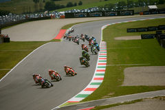 Moto GP race first lap at Mugello 2015. Jorge Lorenzo leads the group at the bucine corner of Mugello circuit during the first lap of the Italian Moto GP race Royalty Free Stock Image