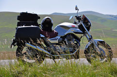 Moto guzzi parked on a country road Royalty Free Stock Image