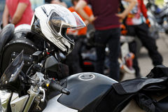 Moto helmet on motorcycle handlebars. Against blurred background Stock Photos