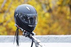 Moto helmet on motorcycle handlebars Stock Photography