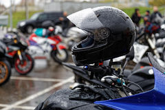 Moto helmet on motorcycle handlebars Royalty Free Stock Photo