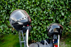 Moto helmet on motorcycle handlebars Stock Photo