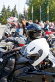 Moto helmets on motorcycles and motorbikes. On blurred background Stock Images