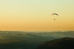 Moto paraglider above the landscape. In sunset, copy space Stock Photography
