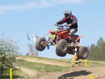 Moto quad jumping from hill Royalty Free Stock Photography