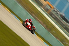Moto Race. Red and white Motorcycle on a curve Royalty Free Stock Photos