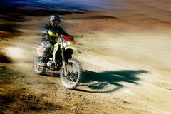 Moto racer in movement Stock Photography
