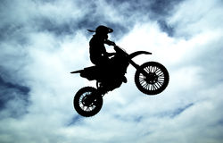 Moto racer in sky Stock Photo