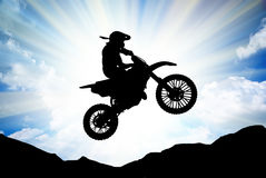 Moto racer in sunny sky. Stock Photo