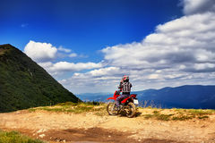 Moto racers riding on mountainous road, drive a motorcycle. Summer adventure, extreme sport, travel to Europe, active lifestyle, vacation concept Stock Images