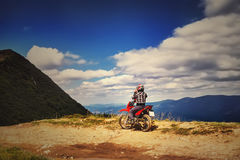 Moto racers riding on mountainous road, drive a motorcycle Royalty Free Stock Image