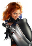 Moto redhead girl Royalty Free Stock Photography