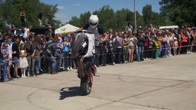 Moto Rider Rides on the Rear Wheel. Stunt Moto Show. Bikers Parade And Show. Slow Motion stock footage